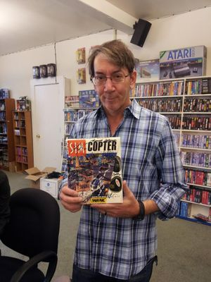 Will Wright with a copy of Sim Copter